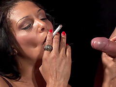 Latina bombshell in a tight dress smokes while slurping on a cock