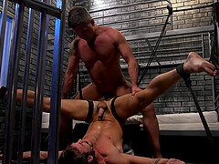 Gay prison BDSM fetish session with buffed dudes in a prison cell