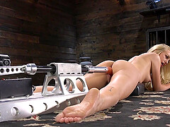 Handsome blonde slut Lyra Law spreads legs for a fuck machine