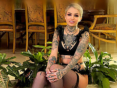 Tattooed short haired beauty Leigh Raven backstage interview