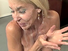 blonde milf adores when her friend cum on her beautiful face and mouth