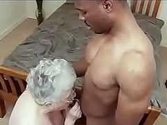 horny granny gets her cunt pounded by a black guy's penis on the bed