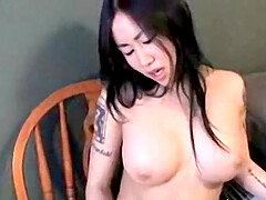 Beautiful Asian amateur with big tits fingers and stuffs her shaved pussy with a dildo