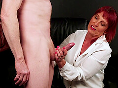 Redheaded Beau Diamonds strokes a throbbing cock and sucks on it